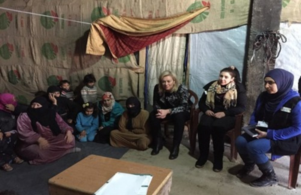 SCL Sigrid Kaag meets refugees at site in Fayda-Omarieh (26 02 15)